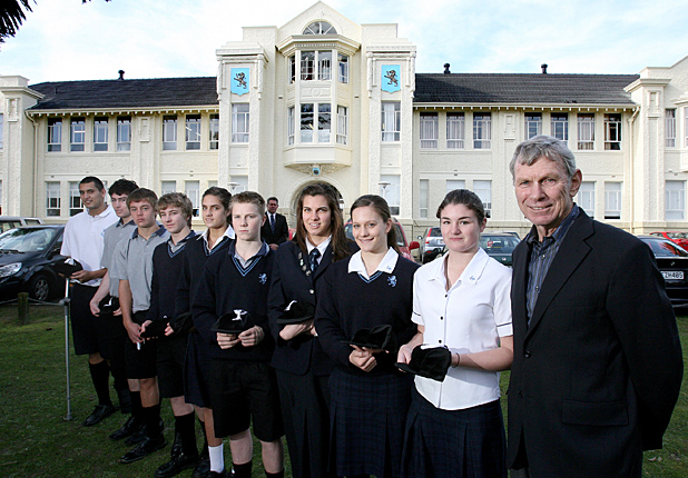 Photo: Jason Oxenham/Auckland Suburbans. Sir Peter Snell with black caps recipients from Mt.Albert Grammar School